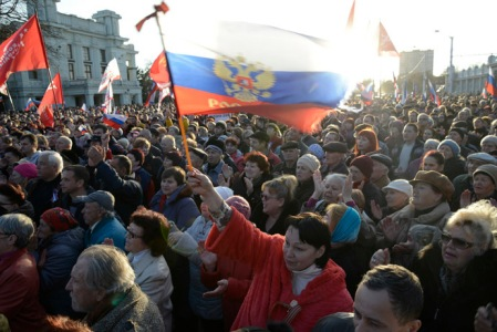 Pro-Russian demonstrators take part in a rally in the Crimean town of Yevpatoria